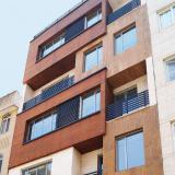 اجرای نما ساختمان ( نمای سیمانی ترکیبی چوب سنگ )